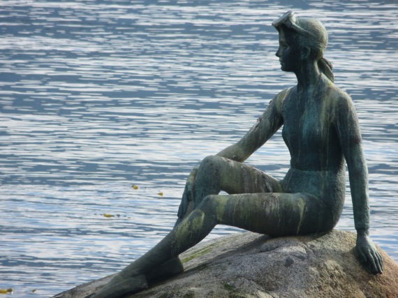 Close up of the girl on a rock
